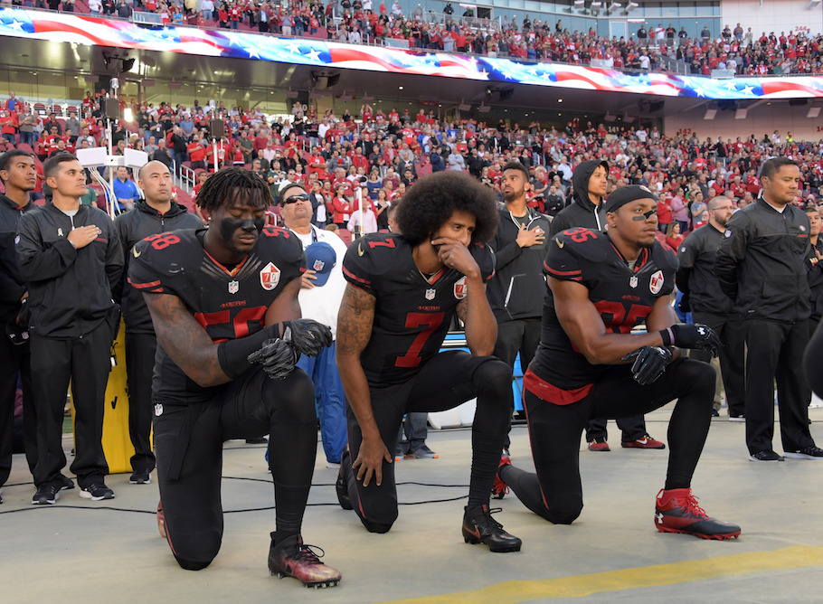 Colin Kaepernick kneeling during the national anthem